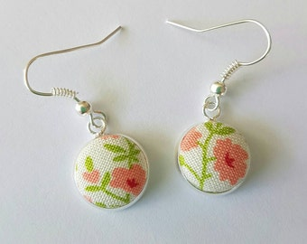 Floral fabric button silver drop earrings.