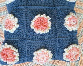 Floral crochet cushion