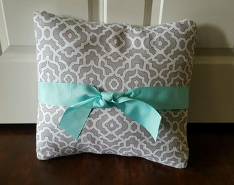 gray and white geometric print pillow cover with aqua bow