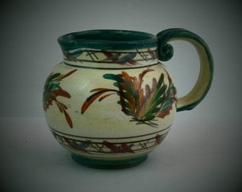 Denby jug in floral pattern  signed by Glyn Colledge. An early piece of Glyn Colledge studio stoneware dating from 1950s