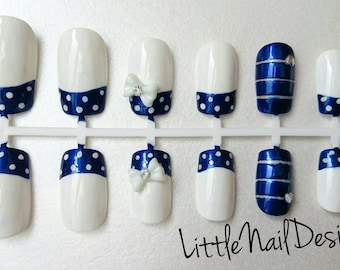 Blue and White Polka dot hand painted false nails with 3D rhinestone bows