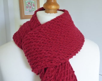 Chunky red hand knitted scarf in a wool and acrylic mix yarn