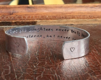 "Mothers and daughters never truly part, maybe in distance, but never in heart. Cuff Bracelet Personalized Jewelry Hand Stamped 1/2"" Aluminum"