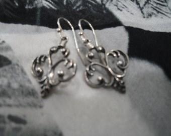 Fleur de Lis sterling silver drop earrings