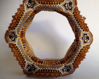winged and horned beaded bangle