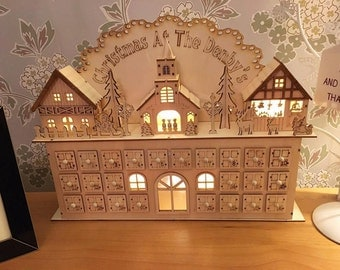 Wooden advent calendar manor house personalised with family name with lights and music