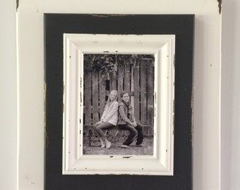 Lightly distressed, 3 layer, black and white 5x7 picture frame.