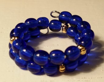 Adjustable Memory Wire Ring made with Navy Blue Glass Beads with Gold Plated Spacers