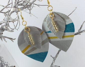 Leather earrings made entirely by hand and painted with enamel.