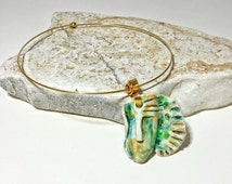 Necklace with green ceramic mask and ocher