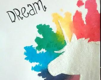 8 1/2x11 silhouetted unicorn in rainbow splatter, 'dream'