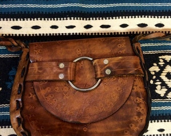 Vintage handmade leather purse with braided strap