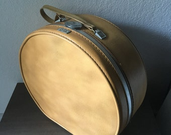 Vintage Amelia Earhart round luggage in yellow gold, hat case, train case
