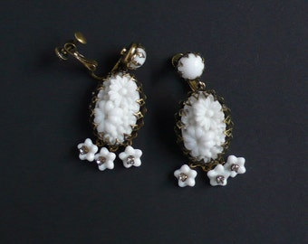 Earrings made with vintage occupied Japan (1940 – 1950) white glass flower stones by DeLuxe Accessories