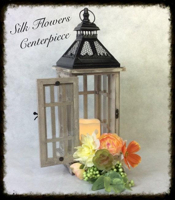Items similar to wedding centerpiece lantern flowers