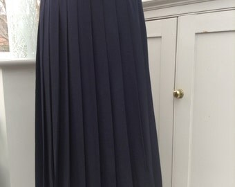Beautiful navy mid-calf pleated skirt made by Hauber of West Germany in 1980's