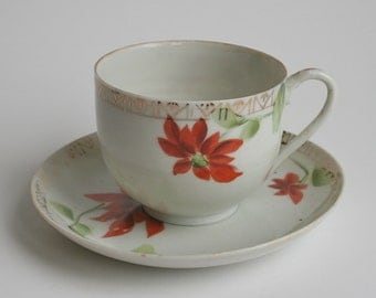 Very old Japanese hand painted cup and saucer, made in Nippon