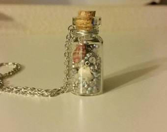 Tiny Bottle Necklace, filled with sea shells and beads