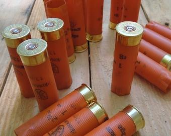 "Shotgun shells (24 size lot) ""CLEMSON ORANGE""/Monarch 12 gauge empty/once fired shotgun shells."