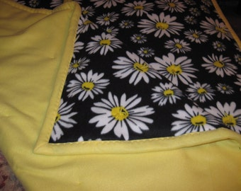 Daisys on black background with yellow backing