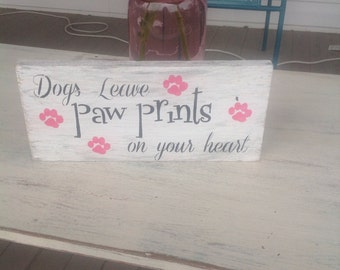 Dogs leave paw prints on your heart sign