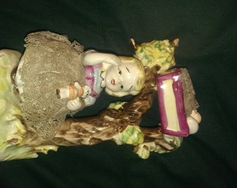 Vintage Lipper and Mann Inc ceramic figurine with lace
