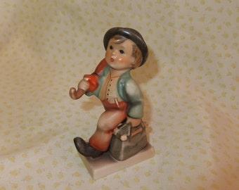 Vintage Hummel Figurine of Boy with Bag and Umbrella
