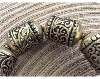 5 beads metal tubes, carved patterns in foliage of Berber origin