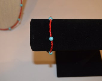 Red with turquoise accents stretch bracelet