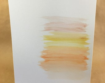 Watercolor brushstrokes in warm tones