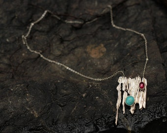 Broomstick cast necklace with turquoise and garnet