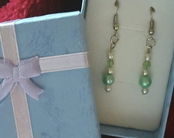 Green, pearl and silver earrings.