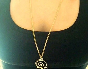 Gold necklace with vintage pendant