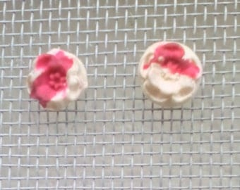 White and painted pink clay earrings.
