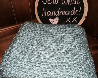 Teal hand knitted cot blanket
