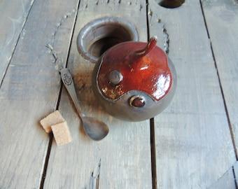 Sugar in stoneware, bronze and red ash