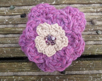 Hand crocheted layered flower brooch in purple and cream