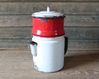 Red and white enamelware coffee pot
