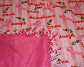 Pink ribbon knotted fleece blanket.