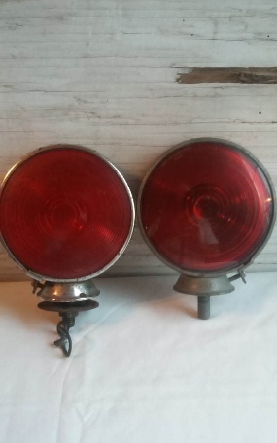 2 Vintage Stimsonite 150A A'G'A Tail Lights.  Both are complete.   Both lenses are intact with no cracks to either.  Both for one money.