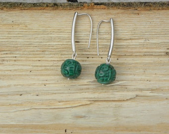 Carved jade on sterling silver