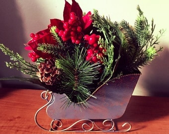 A Beautiful faux poinsettia and greenery centerpiece . Perfect for the holidays.