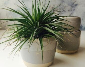 038. Set of three grey ceramic plant pots.  Coffee and tea tumblers. Modern ceramics.