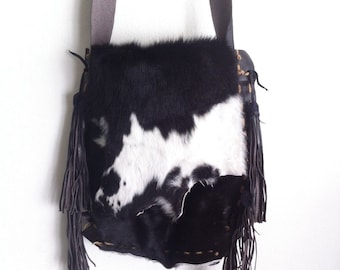 Black white shoulder bag made of natural fur cow and leather, new unique handmade bag.