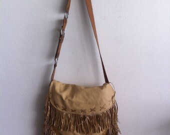 Woman leather bag with fringe