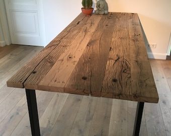 Dining table with thick old oak table top and steel base