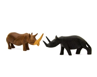 A Pair of Hand Carved Wooden Rhinoceros