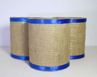 Burlap containers with blue satin ribbon accent