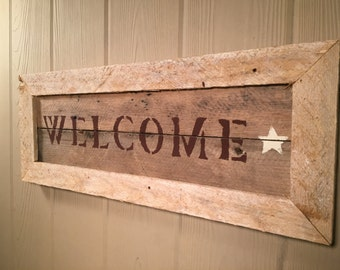 "Rustic ""welcome"" sign made out of reclaimed wood."