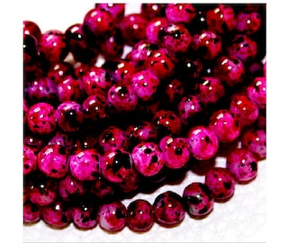 100 black mottled pink glass 4 mm beads